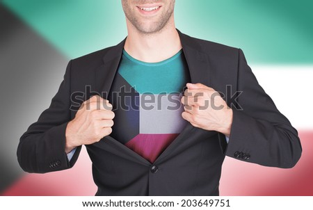 Businessman opening suit to reveal shirt with flag, Kuwait