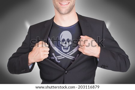 Businessman opening suit to reveal shirt with pirate flag - stock photo
