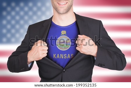 Businessman opening suit to reveal shirt with state flag (USA), Kansas - stock photo