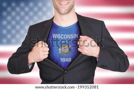 Businessman opening suit to reveal shirt with state flag (USA), Wisconsin - stock photo