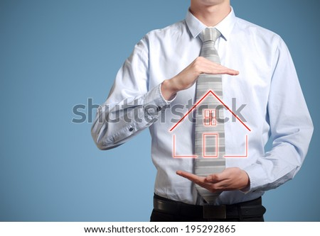 Businessman or banker man holding home or house in hands - stock photo
