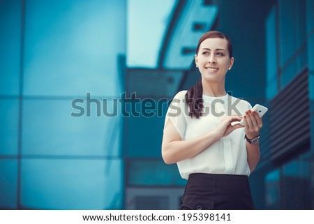 businessman or entrepreneur talking on cellphone. City businesswoman working. - stock photo