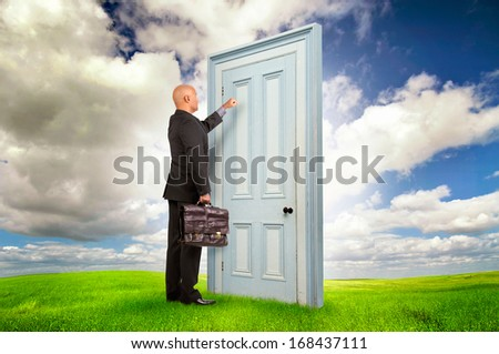 Businessman or salesman with briefcase knocking at a door outdoors - stock photo