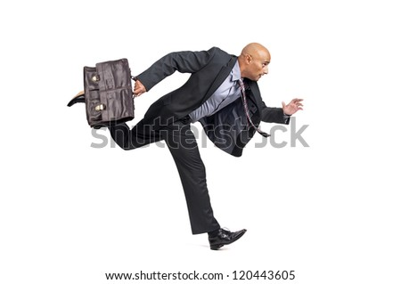 Businessman or salesman with briefcase running isolated in white - stock photo