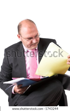 Businessman organizing his files in different colour folders