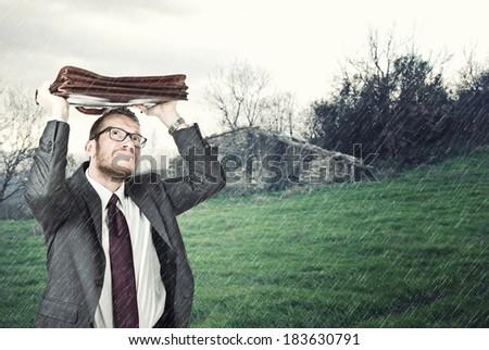 businessman outdoor and heavy rain - stock photo