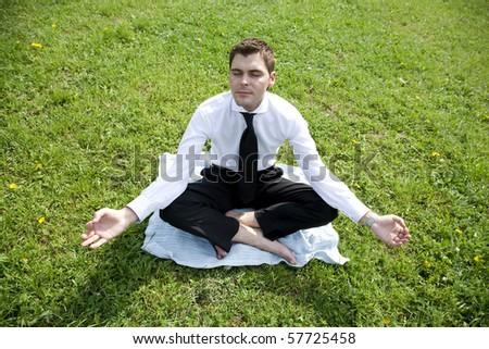 businessman outdoor do yoga exercise - stock photo