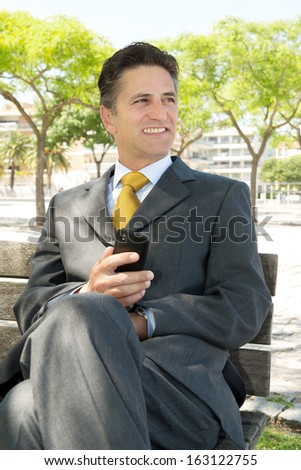 Businessman outdoors with cellphone