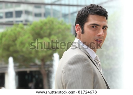 Businessman outside - stock photo