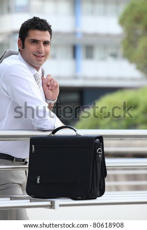 Businessman outside with his briefcase - stock photo