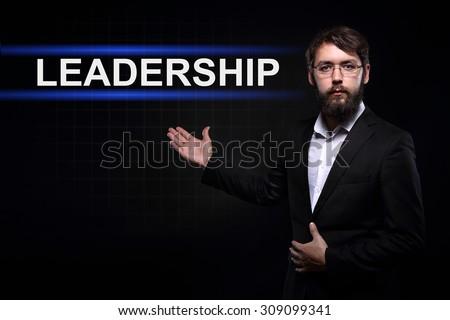 Businessman over black background presenting leadership  concept.  - stock photo