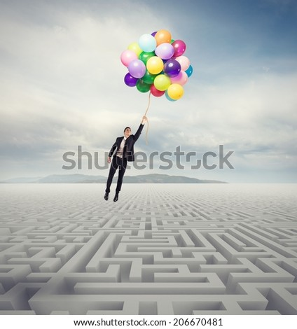 Businessman overcomes the obstacle with a flying businessman - stock photo