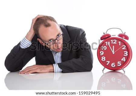 Businessman overworked with red clock isolated on white background - stock photo