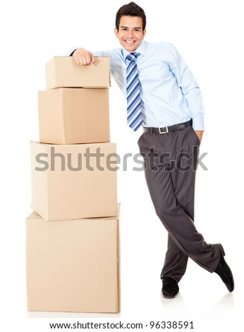 Businessman packing in carton boxes and getting ready for moving - isolated - stock photo
