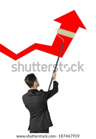 businessman painting big red arrow - stock photo