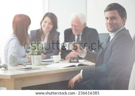 Businessman participating in business meeting in modern workplace