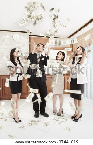 Businessman paying in cash to the businesswoman with another employees witnessing it - stock photo