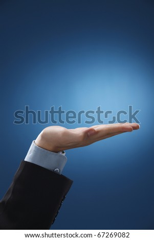 Businessman performing a hand gesture. - stock photo