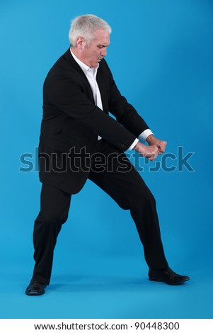 Businessman performing pull gesture - stock photo