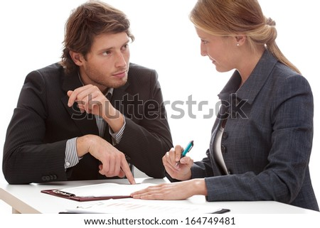 Businessman persuading his financial partner to signing a contract - stock photo