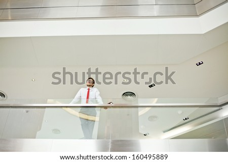 businessman photographed from distance - stock photo