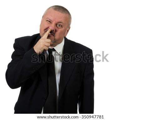 Businessman picks nose isolated on white - stock photo