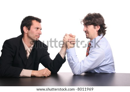 businessman playing arm restling - stock photo
