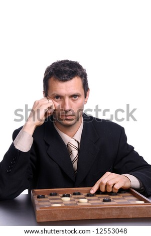 businessman playing chess over white background