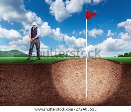 Businessman playing golf - stock photo