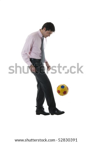 Businessman playing soccer/football, isolated on white
