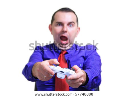 Businessman playing video game - stock photo