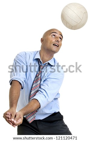 Businessman playing volleyball - stock photo