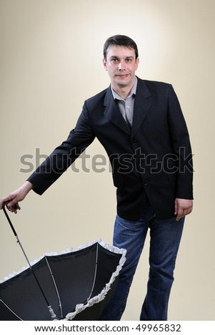 businessman playing with umbrella - stock photo