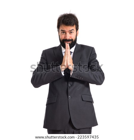Businessman pleading over white background