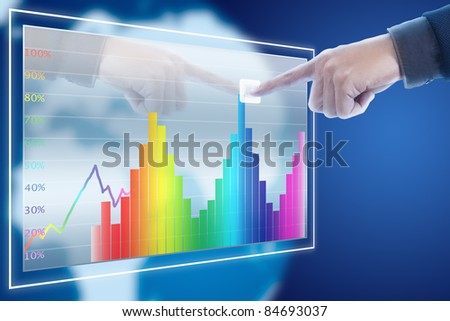 businessman point finger to stock market graph - stock photo