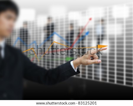 Businessman point graph - stock photo