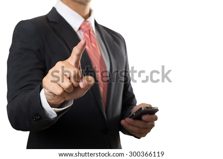 Businessman Point his finger and holding smartphone - stock photo