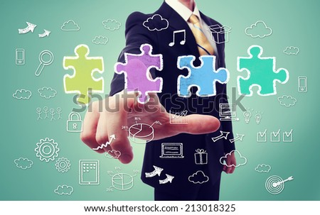Businessman pointing a piece of the puzzle with business concept cartoon - stock photo