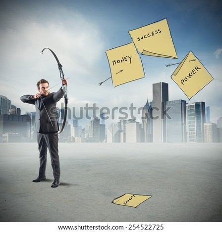 Businessman pointing and hits his work goals - stock photo