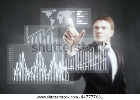 Businessman pointing at abstract business chart on concrete background - stock photo
