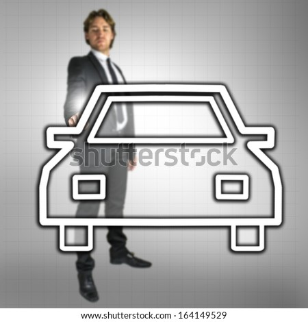 Businessman pointing at car icon on virtual screen. Concept of car dealership business. - stock photo