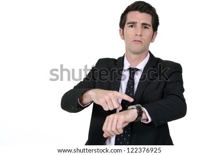 Businessman pointing at his watch - stock photo