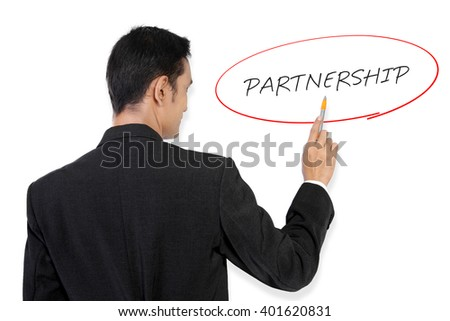 "Businessman pointing at ""Partnership"" handwritten text on white board with his pen"