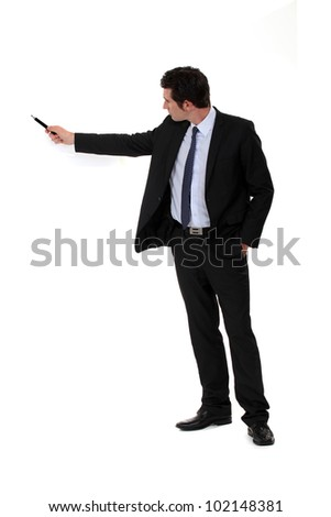businessman pointing at something with his pen - stock photo