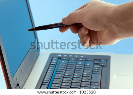 Businessman pointing at the screen of a laptop computer