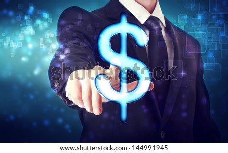 Businessman pointing Dollar icon with blue tech background - stock photo
