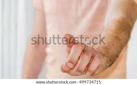Businessman pointing finger on clear office background