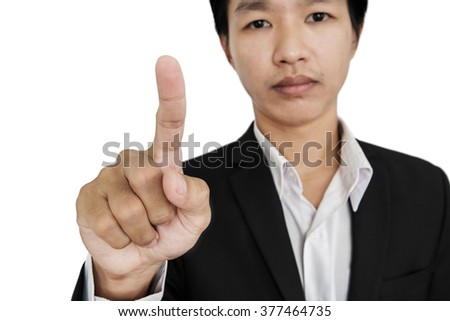 Businessman pointing finger to screen, selective focus, isolated on white background - stock photo