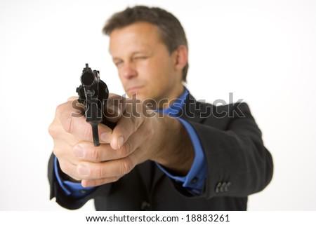 Businessman Pointing Gun - stock photo