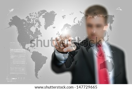Businessman pointing his finger on a hi-tech world map